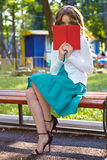 Young woman reads book. Stock Photo