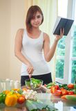 Young woman reads cookbook Royalty Free Stock Photos