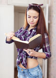 Young woman reads cookbook Royalty Free Stock Photography