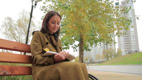 Young Woman Reads Outdoors stock video