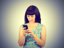 Young woman reads the SMS, the news on the phone. Stock Image