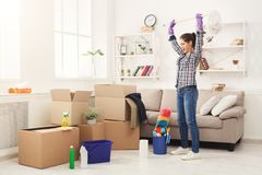Young woman ready to clean her new apartment after moving Stock Images