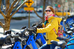 Young woman ready to rent a bike in New York. Young beautiful woman ready to rent a city bike in New York, USA Stock Photos