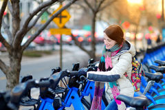 Young woman ready to rent a bike in New York Royalty Free Stock Image