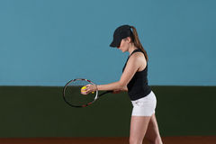 Young Woman Ready To Serves Toss Ball Stock Photo