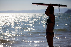 Young woman ready to surf Royalty Free Stock Images