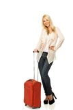 Young woman ready to travel. Blond woman with a suitcase Stock Photo