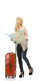 Young woman ready to travel. Blond woman with suitcase and map Royalty Free Stock Photo