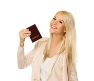 Young woman ready to travel. Happy blond woman with passport Stock Photography