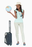 Young woman ready to travel the world. Against a white background Stock Images