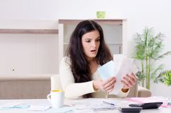The young woman with receipts in budget planning concept. Young woman with receipts in budget planning concept royalty free stock photos