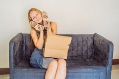 Young woman received online shopping parcel opening boxes and buying fashion items by using credit card royalty free stock photo