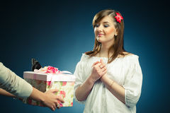 Young woman receives a gift Royalty Free Stock Photo
