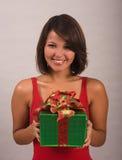 Young woman receives a present Stock Photos