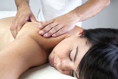 Young woman receiving a back massage Royalty Free Stock Image