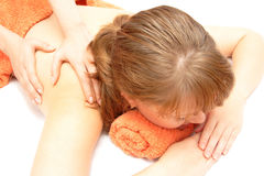 Young woman receiving back massage Royalty Free Stock Photography