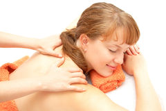 Young woman receiving back massage Stock Image