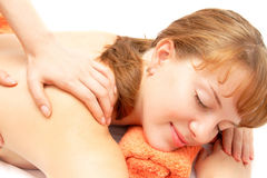 Young woman receiving back massage Royalty Free Stock Image