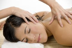 Young woman receiving back massage Stock Photo