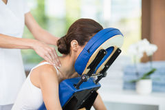 Young woman receiving back massage Royalty Free Stock Photos