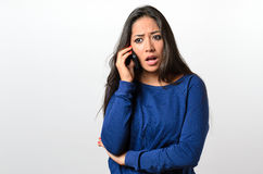 Young woman receiving bad news on her mobile Royalty Free Stock Image