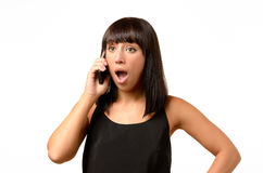 Young woman receiving bad news on her mobile Royalty Free Stock Photos