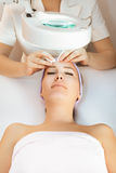 Beauty therapy. Young woman receiving beauty therapy stock image