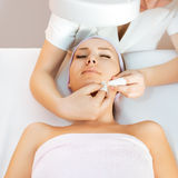 Beauty therapy. Young woman receiving beauty therapy royalty free stock photos