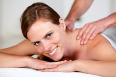 Young woman receiving a body massage at a spa Royalty Free Stock Photo