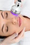 Young woman receiving cavitation facial massage Royalty Free Stock Photos
