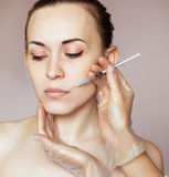 Young woman receiving cosmetic injection Stock Images