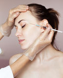 Young woman receiving cosmetic injection Stock Photo