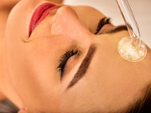 Young woman receiving electric facial massage. Stock Photography