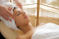 Young woman receiving energy therapy, eyes closed Royalty Free Stock Photos