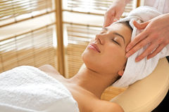 Young woman receiving energy therapy, eyes closed. Young women receiving energy therapy, eyes closed stock image