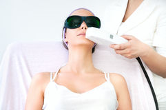 Young woman receiving epilation laser treatment Royalty Free Stock Image