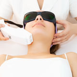 Young woman receiving epilation laser treatment stock photo