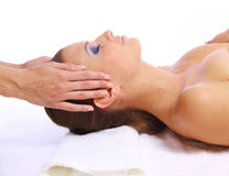 Young woman receiving facial massage Royalty Free Stock Image