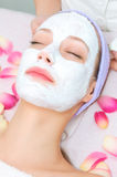 Young woman receiving facial treatment Stock Photos