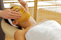 Young woman receiving facial treatment in spa Royalty Free Stock Photo