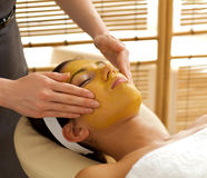 Young woman receiving facial treatment in spa Royalty Free Stock Photos