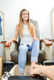 Young woman receiving foot massage Royalty Free Stock Image