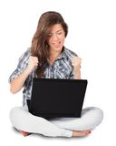 Young woman receiving good news on her laptop Royalty Free Stock Images