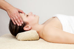 Young woman receiving head massage Stock Image