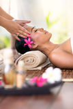 Young woman receiving head massage Royalty Free Stock Images