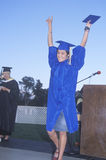 Young woman receiving her high school diploma Royalty Free Stock Images
