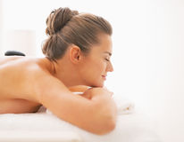 Young woman receiving hot stone massage Stock Images