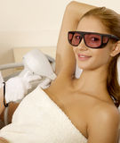 Young woman receiving laser therapy Stock Photography