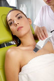 Young woman receiving laser therapy Royalty Free Stock Image