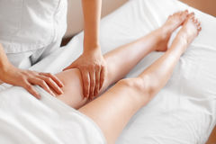 Young Woman Receiving Leg Massage at Spa Center. Body Care Royalty Free Stock Images